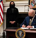 President Biden signs executive orders while Vice President Harris looks on. Photo by Anna Moneymaker for the New York Times
