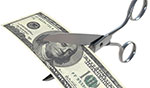 paycut: scissors cutting $100 bill